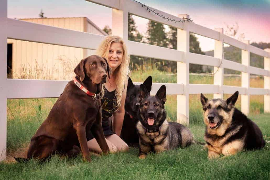 woman with her pack of service dogs