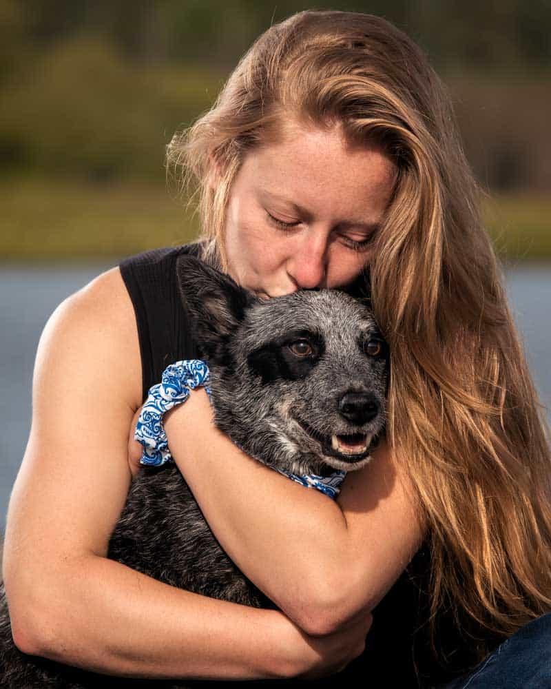 women hugs her dog