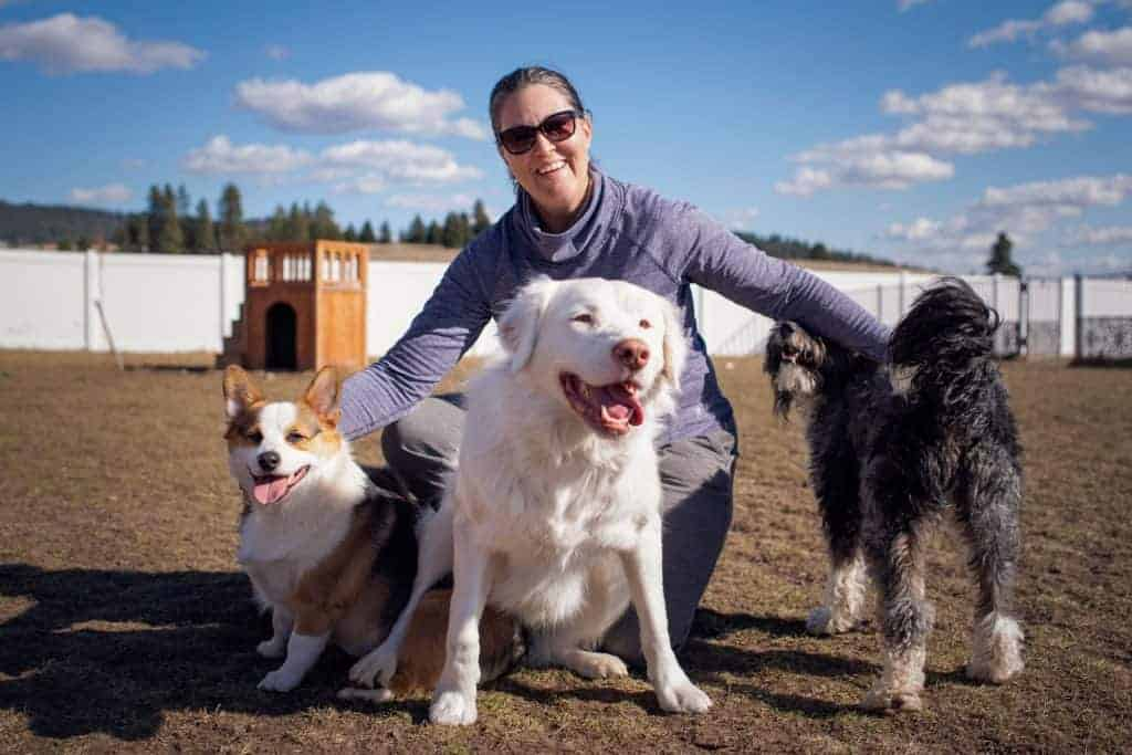Amy Fumetti with clients at her dog boarding facility in Valleyford