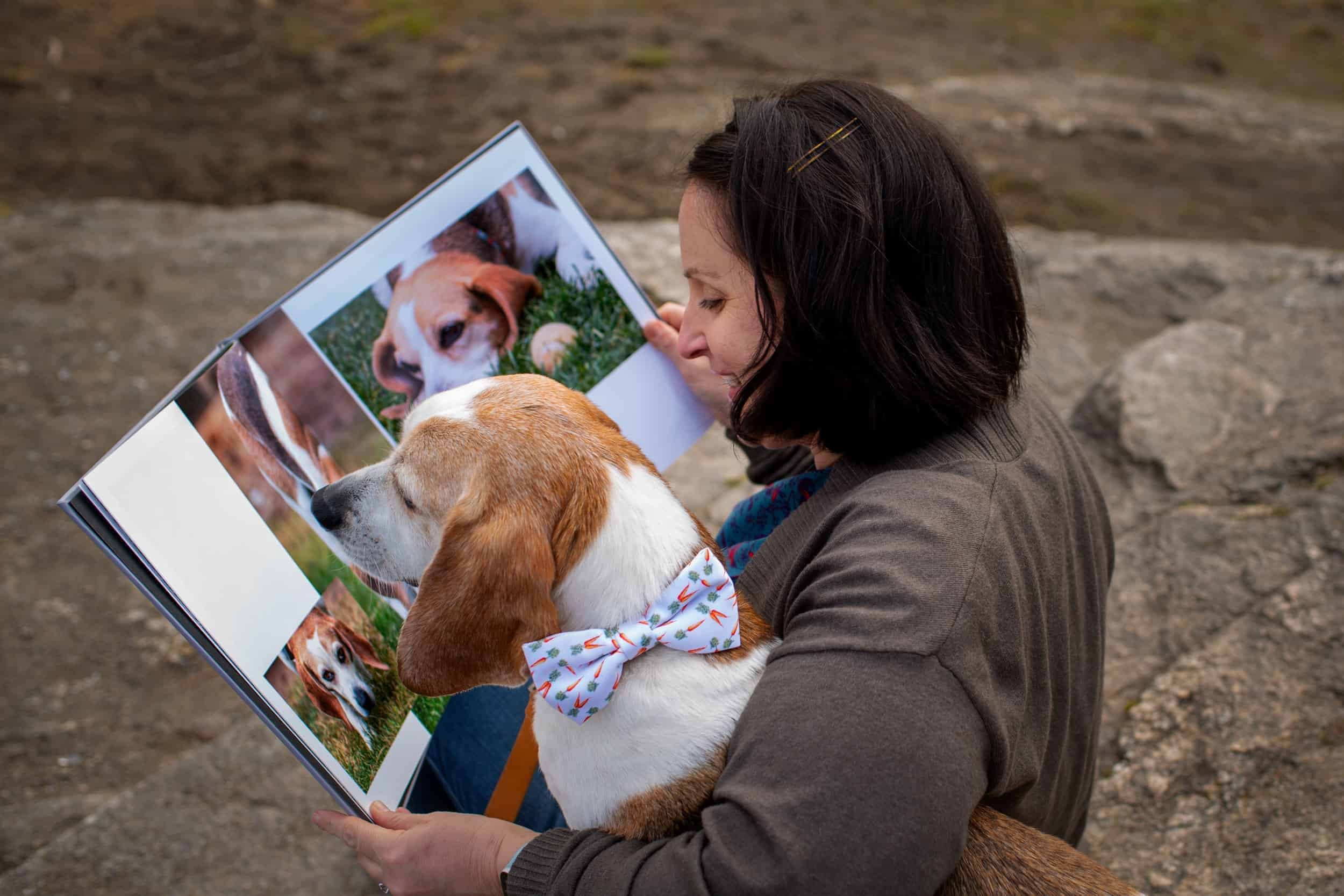 Jamie and her beagle reading a photo album