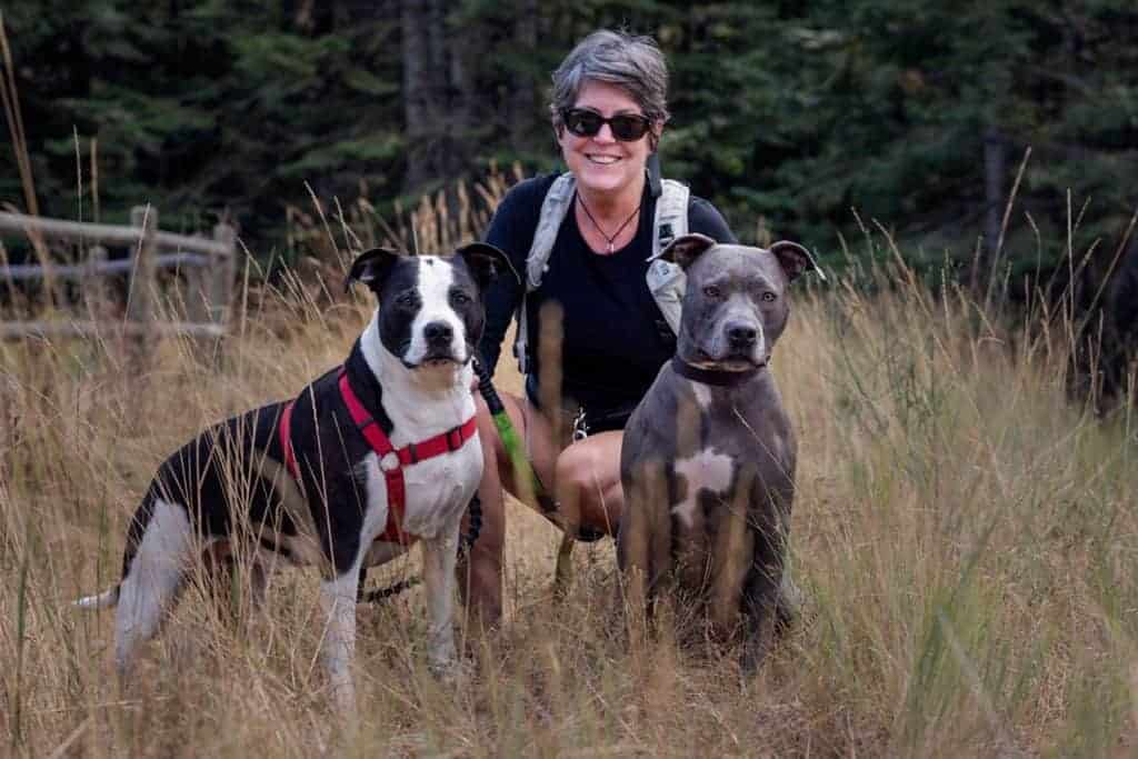 Kate Rau with her hiking pitbulls at Mica Conservation