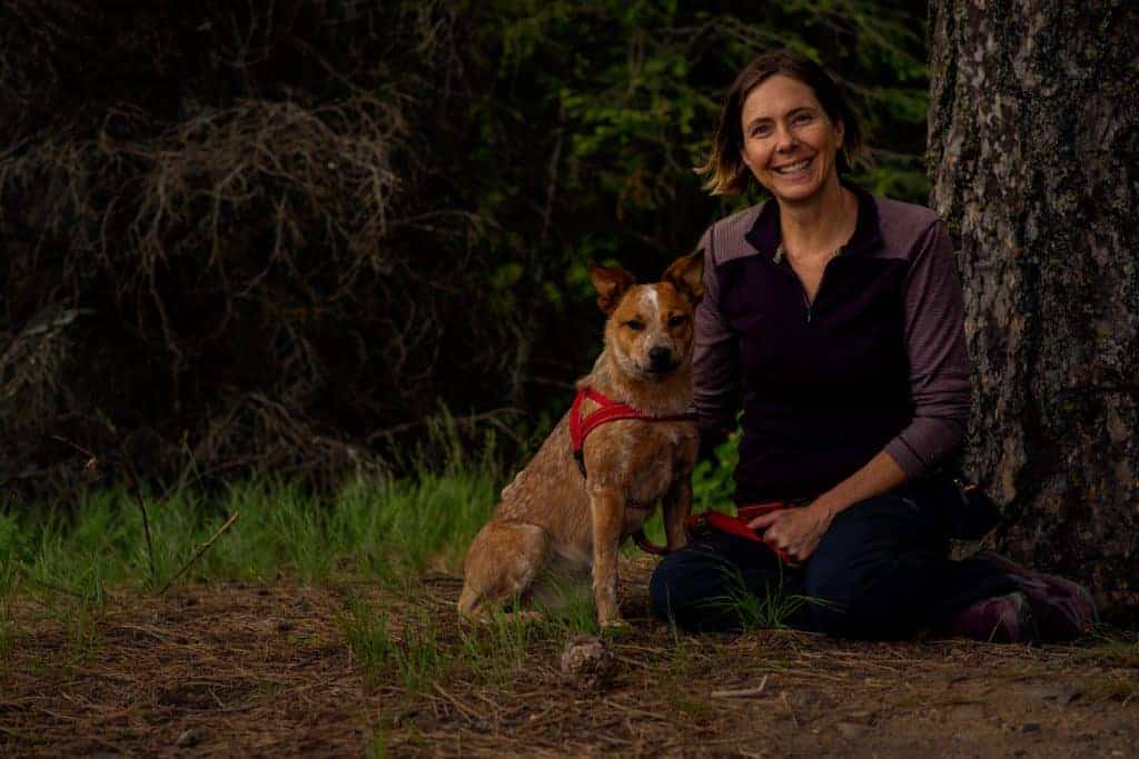 woman and her heeler posing during adventure dog photo sessions