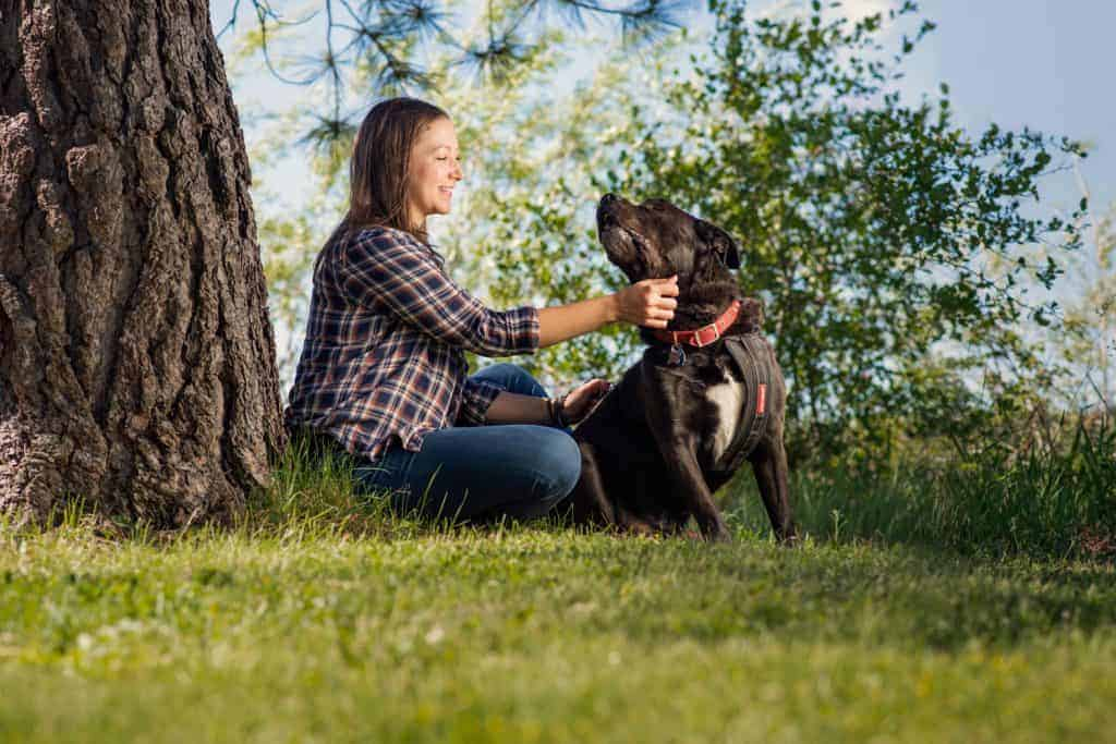 woman with her rescue dog in North Idaho