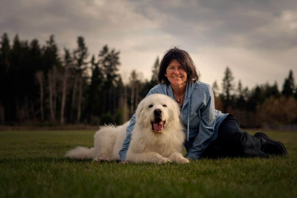woman with her Great Pyrenees at Hauser Lake in Idaho